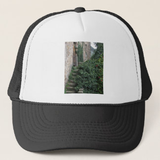 Old abandoned country homestead in the woods trucker hat