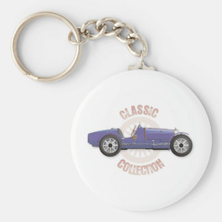Old blue vintage racing car used on the track keychain