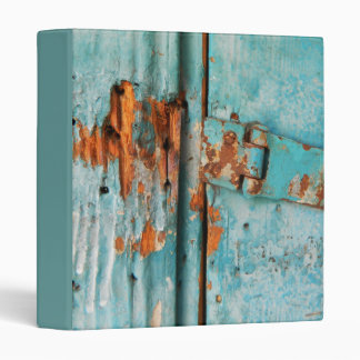 Old blue wooden door with rusted latch binder