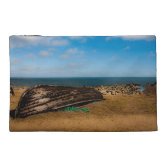 Old boat on the shore travel accessories bag
