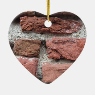 Old brick wall background ceramic heart ornament
