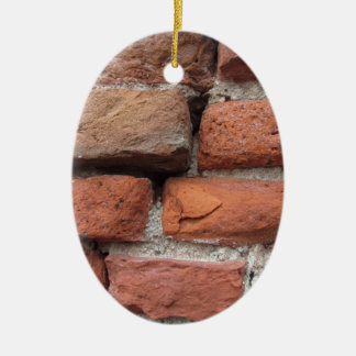 Old brick wall background ceramic oval ornament