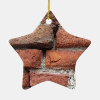 Old brick wall background ceramic star ornament