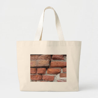 Old brick wall background large tote bag