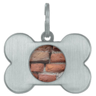 Old brick wall background pet name tag