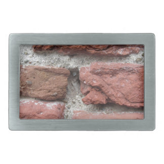 Old brick wall background rectangular belt buckles