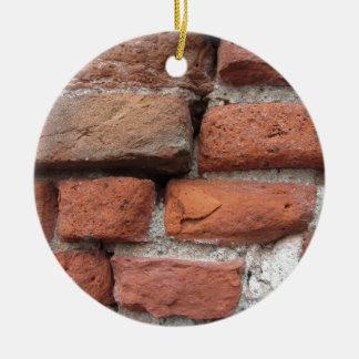 Old brick wall background round ceramic ornament