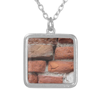 Old brick wall background silver plated necklace