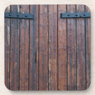 Old Brown Wood Doors With Black Iron Supports Coaster