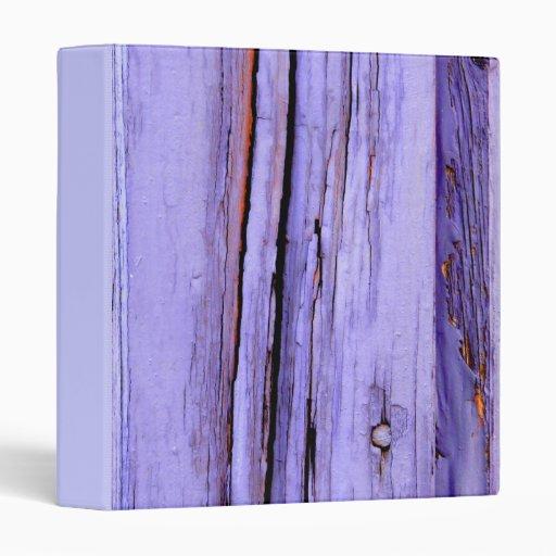 Old cracked purple paint on wood binder