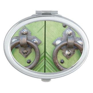 Old door compact mirrors