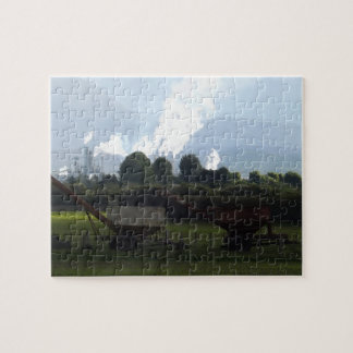 old farm equipment and industry over fields jigsaw puzzle
