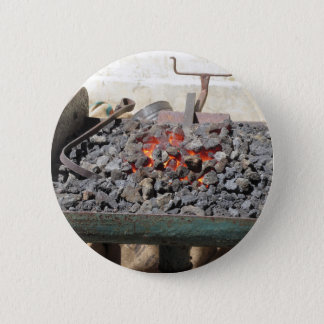Old-fashioned blacksmith furnace . Burning coals 2 Inch Round Button