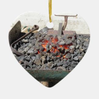 Old-fashioned blacksmith furnace . Burning coals Ceramic Heart Ornament