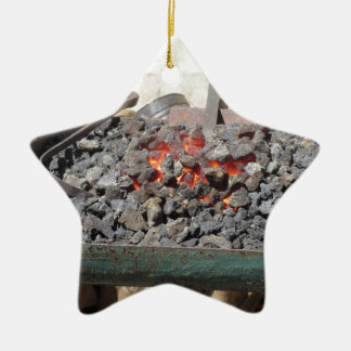 Old-fashioned blacksmith furnace . Burning coals Ceramic Star Ornament