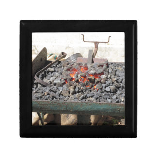 Old-fashioned blacksmith furnace . Burning coals Gift Box