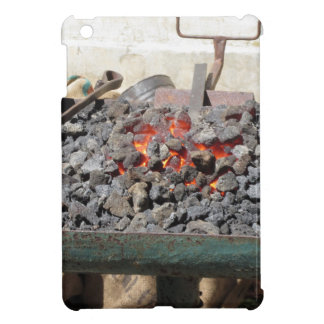 Old-fashioned blacksmith furnace . Burning coals iPad Mini Cases