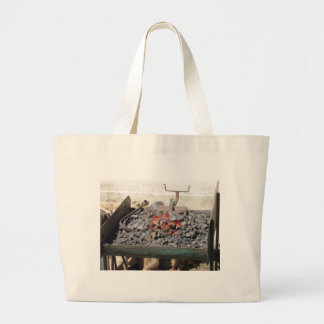 Old-fashioned blacksmith furnace . Burning coals Large Tote Bag