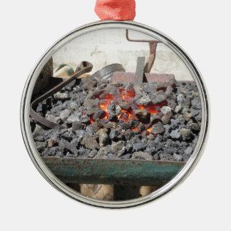 Old-fashioned blacksmith furnace . Burning coals Metal Ornament