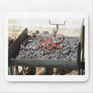 Old-fashioned blacksmith furnace . Burning coals Mouse Pad