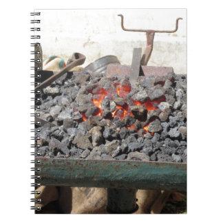Old-fashioned blacksmith furnace . Burning coals Notebook