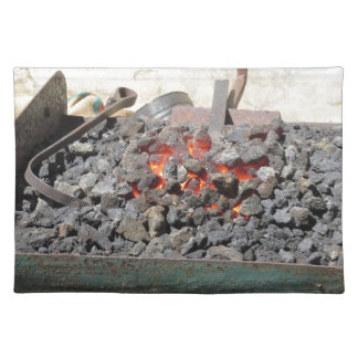 Old-fashioned blacksmith furnace . Burning coals Placemat