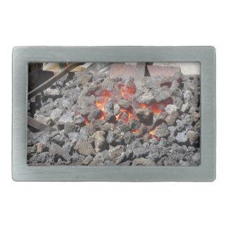 Old-fashioned blacksmith furnace . Burning coals Rectangular Belt Buckles
