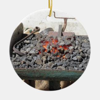 Old-fashioned blacksmith furnace . Burning coals Round Ceramic Ornament
