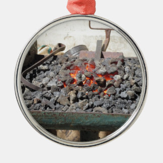 Old-fashioned blacksmith furnace . Burning coals Silver-Colored Round Ornament