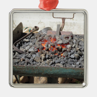 Old-fashioned blacksmith furnace . Burning coals Silver-Colored Square Ornament