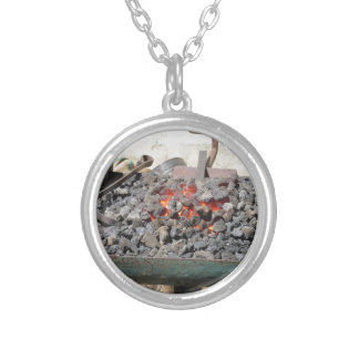 Old-fashioned blacksmith furnace . Burning coals Silver Plated Necklace