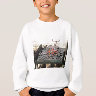 Old-fashioned blacksmith furnace . Burning coals Sweatshirt