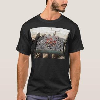 Old-fashioned blacksmith furnace . Burning coals T-Shirt