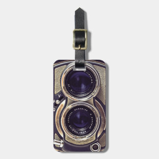 Old-fashioned camera luggage tag