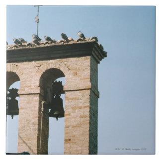 Old-fashioned church bells, Assisi, Italy Tiles
