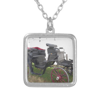 Old-fashioned horse carriage on green grass silver plated necklace