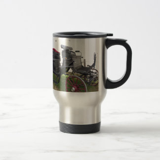Old-fashioned horse carriage on green grass travel mug