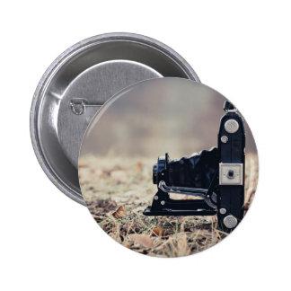 Old folding camera pins