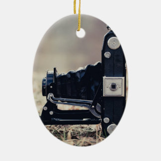 Old folding camera ceramic oval ornament