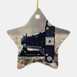 Old folding camera ceramic star ornament