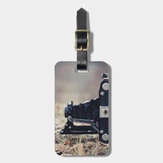 Old folding camera luggage tag