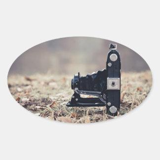 Old folding camera oval sticker