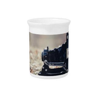 Old folding camera drink pitcher