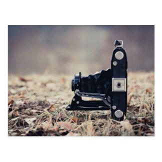 Old folding camera postcard