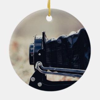 Old folding camera round ceramic ornament