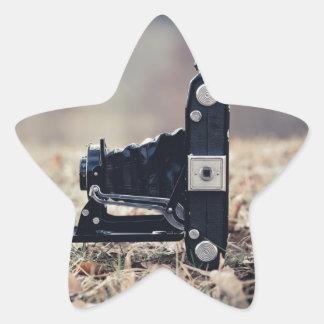 Old folding camera star sticker