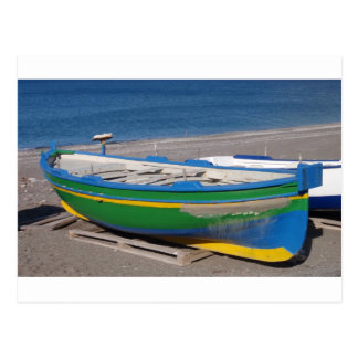 Old green fishing boat on beach. postcard