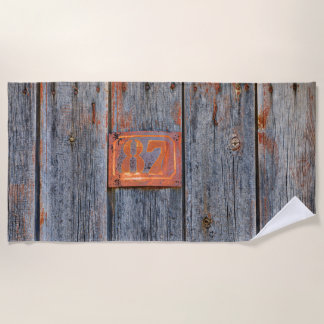 """Old Grunge Rusty Metal House Number No. 87 Photo """" Beach Towel"""