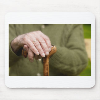old hands OF A senior lean on walking stick Mouse Pads