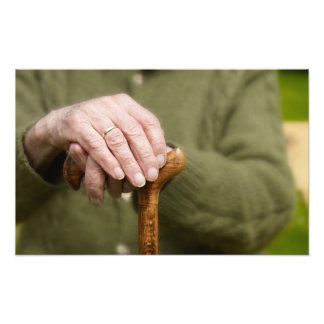 old hands OF A senior lean on walking stick Photo Print